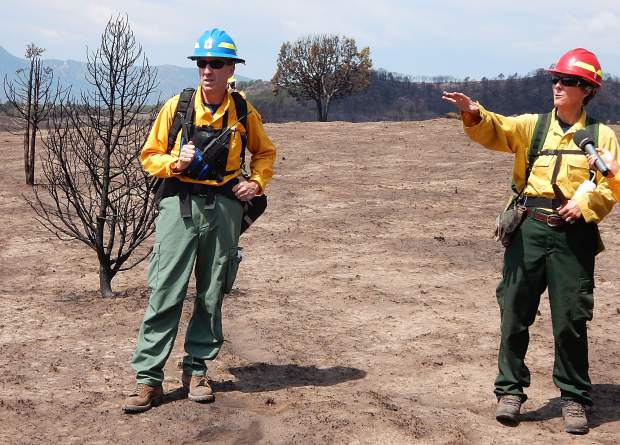 Steve Hunter, a civil engineer and hydrologist, and hydrologist Liz Schnackerberg, both with the U.S. Forest Service, were part of a Burned Area Emergency Response team that continued an assessment of the Lake Christine Fire terrainin July.