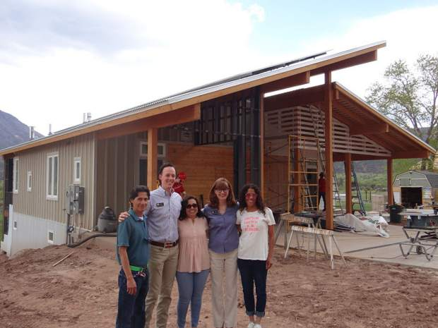Colorado State Rep. Dylan Roberts (second from left) and State Rep. Julie McCluskie (second from right) meet with homeowners at the Basalt Vista affordable housing project last week.