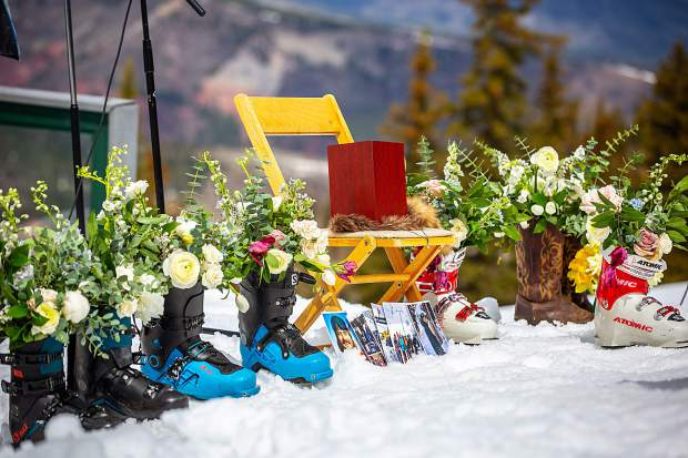 Ski boots filled with flowers and pictures of Sam Coffey pay homage to the loss of a beloved local.
