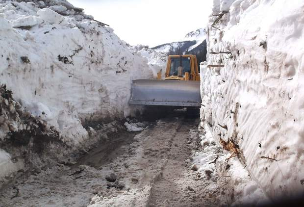 Glenn and Kim Schryver undertook an intense effort to plow through the snow on Lincoln Creek Road this winter. It took 13 days to bust through this year because of all the avalanche debris.