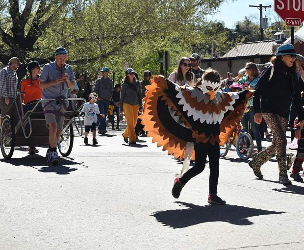 Hundreds participated in Carbondale's parade of species, dressed up as real or imaginary animals, to celebrate Dandelion Day.