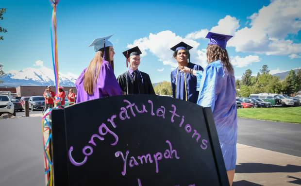 Yampah Mountain High School graduates chat before the commencement ceremony held in Carbondale on Friday morning.