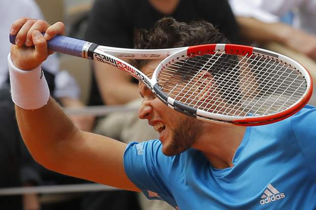 Austria's Dominic Thiem plays a shot against Spain's Rafael Nadal during the men's final match of the French Open tennis tournament at the Roland Garros stadium in Paris, Sunday, June 9, 2019. (AP Photo/Michel Euler)
