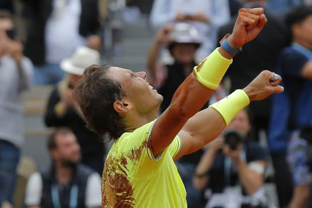 Spain's Rafael Nadal celebrates his record 12th French Open tennis tournament title after winning his men's final match against Austria's Dominic Thiem in four sets, 6-3, 5-7, 6-1, 6-1, at the Roland Garros stadium in Paris, Sunday, June 9, 2019. (AP Photo/Michel Euler)