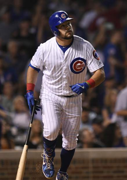 Chicago Cubs' Kyle Schwarber watches his solo home run during the fifth inning of a baseball game against the Colorado Rockies Tuesday, June 4, 2019, in Chicago. (AP Photo/Paul Beaty)