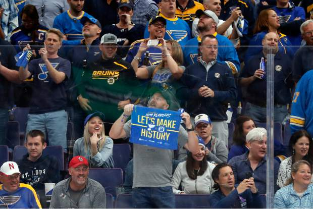 St. Louis Blues fans celebrate during the third period of Game 4 of the NHL hockey Stanley Cup Final against the Boston Bruins Monday, June 3, 2019, in St. Louis. (AP Photo/Jeff Roberson)