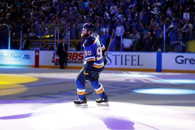 St. Louis Blues center Ryan O'Reilly (90) leaves the ice after the Blues beat the Boston Bruins in Game 4 of the NHL hockey Stanley Cup Final Monday, June 3, 2019, in St. Louis. O'Reilly scored two goals as the Blues won 4-2 to tie the series 2-2. (AP Photo/Jeff Roberson)