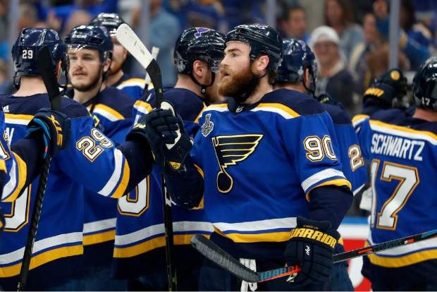 St. Louis Blues center Ryan O'Reilly (90) celebrates after the Blues beat the Boston Bruins in Game 4 of the NHL hockey Stanley Cup Final Monday, June 3, 2019, in St. Louis. O'Reilly scored two goals as the Blues won 4-2 to tie the series 2-2. (AP Photo/Jeff Roberson)