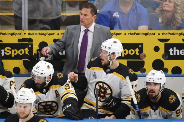Boston Bruins head coach Bruce Cassidy watches the action during the first period of Game 4 of the NHL hockey Stanley Cup Final against the St. Louis Blues Monday, June 3, 2019, in St. Louis. (AP Photo/Scott Kane)