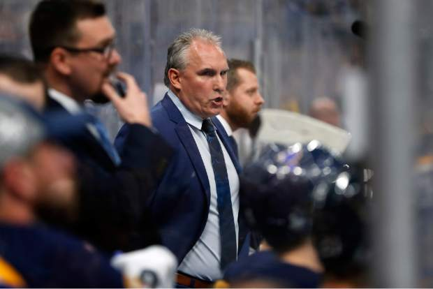St. Louis Blues head coach Craig Berube, center, talks to his players during the first period of Game 4 of the NHL hockey Stanley Cup Final against the Boston Bruins Monday, June 3, 2019, in St. Louis. The Blues won 4-2 to even the series 2-2. (AP Photo/Jeff Roberson)