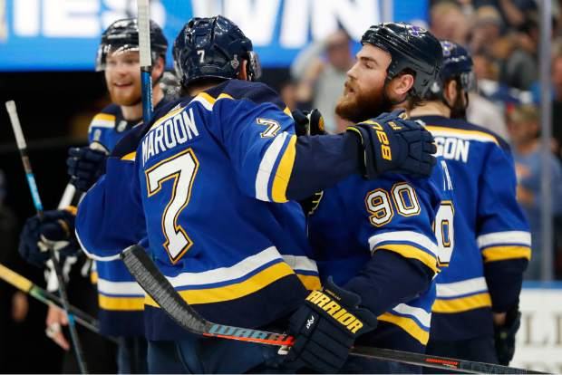 St. Louis Blues center Ryan O'Reilly (90) celebrates with left wing Pat Maroon (7) after the Blues beat the Boston Bruins in Game 4 of the NHL hockey Stanley Cup Final Monday, June 3, 2019, in St. Louis. O'Reilly scored twice as the Blues won 4-2 to even the series 2-2. (AP Photo/Jeff Roberson)