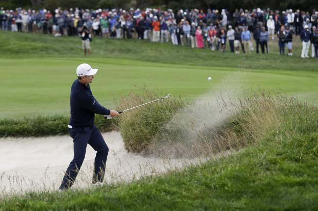 Justin Rose, of England, hits out of the bunker on the 15th hole during the final round of the U.S. Open Championship golf tournament Sunday, June 16, 2019, in Pebble Beach, Calif. (AP Photo/Marcio Jose Sanchez)