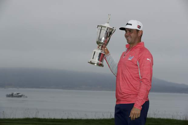 Gary Woodland posses with the trophy after winning the U.S. Open Championship golf tournament Sunday, June 16, 2019, in Pebble Beach, Calif. (AP Photo/Matt York)