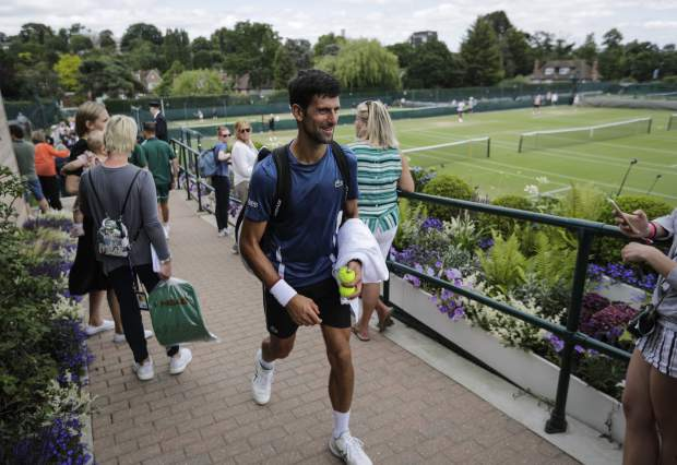 Serbia's Novak Djokovic leaves after playing a practice session ahead of the Wimbledon Tennis Championships in London Sunday, June 30, 2019. (AP Photo/Ben Curtis)