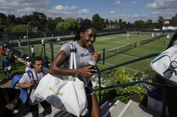 United States' Cori Gauff smiles as she leaves after playing a practice session ahead of the Wimbledon Tennis Championships in London Sunday, June 30, 2019. (AP Photo/Ben Curtis)