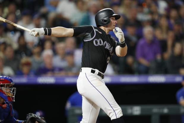 Colorado Rockies' Ryan McMahon follows the flight of his RBI-single off Chicago Cubs relief pitcher Steve Cishek in the eighth inning of a baseball game Monday, June 10, 2019, in Denver. (AP Photo/David Zalubowski)