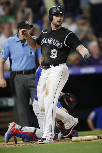 Colorado Rockies' Daniel Murphy crosses home plate to score the go-ahead run on a single hit by Ryan McMahon off Chicago Cubs relief pitcher Steve Cishek in the eighth inning of a baseball game Monday, June 10, 2019, in Denver. (AP Photo/David Zalubowski)
