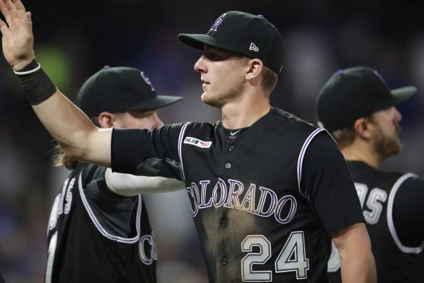 Colorado Rockies second baseman Ryan McMahon is congratulated by teammates after the ninth inning of a baseball game against the Chicago Cubs, Monday, June 10, 2019, in Denver. The Rockies won 6-5. McMahon drove in the go-ahead run with a single in the eighth inning. (AP Photo/David Zalubowski)