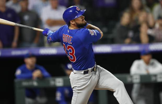 Chicago Cubs' David Bote singles off Colorado Rockies relief pitcher Wade Davis in the ninth inning of a baseball game Monday, June 10, 2019, in Denver. (AP Photo/David Zalubowski)