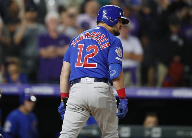 Chicago Cubs' Kyle Schwarber reacts after striking out against Colorado Rockies relief pitcher Wade Davis to end the ninth inning of a baseball game Monday, June 10, 2019, in Denver. (AP Photo/David Zalubowski)
