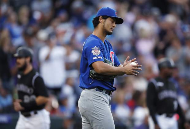 Chicago Cubs starting pitcher Yu Darvish reacts after giving up a two-run home run to Colorado Rockies' Nolan Arenado in the third inning of a baseball game Monday, June 10, 2019, in Denver. (AP Photo/David Zalubowski)