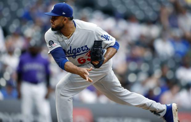 Los Angeles Dodgers relief pitcher Yimi Garcia works against the Colorado Rockies in the ninth inning of a baseball game Sunday, June 30, 2019, in Denver. (AP Photo/David Zalubowski)
