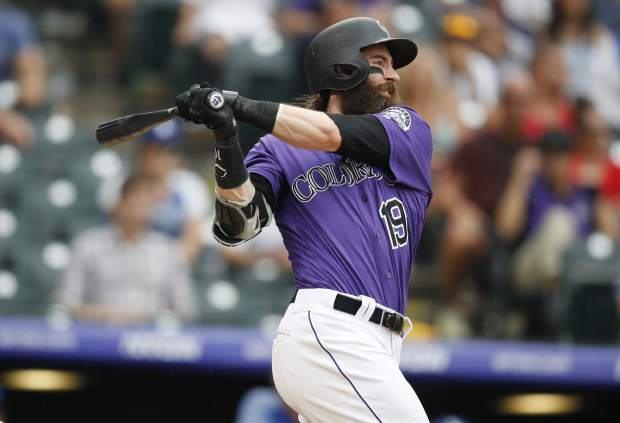 Colorado Rockies' Charlie Blackmon follows the flight of his solo home run off Los Angeles Dodgers relief pitcher Yimi Garcia in the ninth inning of a baseball game Sunday, June 30, 2019, in Denver. (AP Photo/David Zalubowski)