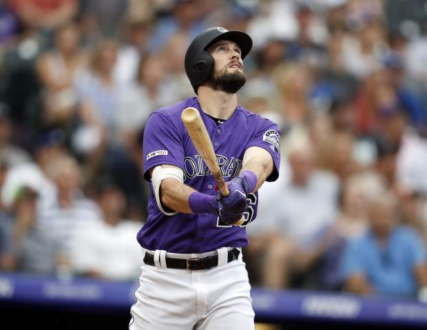 Colorado Rockies' David Dahl follows the flight of his three-run home run off Los Angeles Dodgers relief pitcher Zac Rosscup in the fifth inning of a baseball game Sunday, June 30, 2019, in Denver. (AP Photo/David Zalubowski)