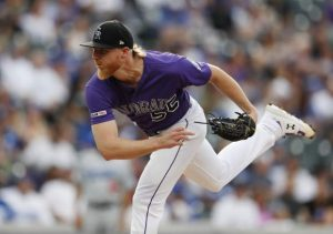 Blackmon homers, Gray pitches Rockies past Dodgers 5-3