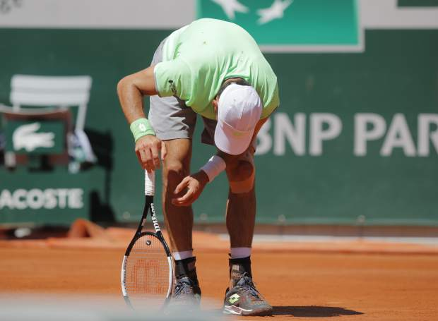 Argentina's Leonardo Mayer reacts after missing a shot against Switzerland's Roger Federer during their fourth round match of the French Open tennis tournament at the Roland Garros stadium in Paris, Sunday, June 2, 2019. (AP Photo/Michel Euler)