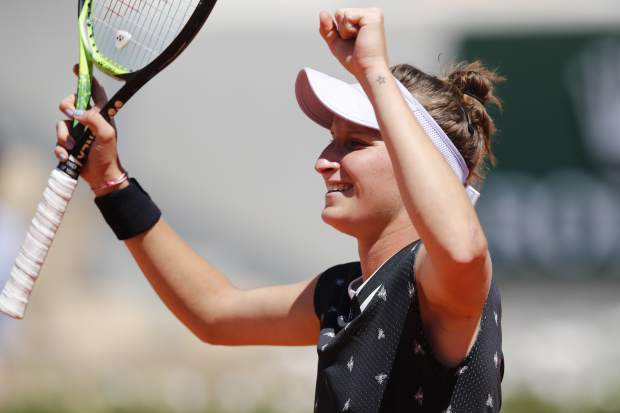 Marketa Vondrousova of the Czech Republic celebrates winning her fourth round match of the French Open tennis tournament against Latvia's Anastasija Sevastova in two sets 6-2, 6-0, at the Roland Garros stadium in Paris, Sunday, June 2, 2019. (AP Photo/Christophe Ena)