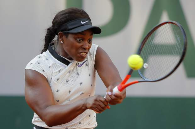 Sloane Stephens of the U.S. plays a shot against Spain's Garbine Muguruza during their fourth round match of the French Open tennis tournament at the Roland Garros stadium in Paris, Sunday, June 2, 2019. (AP Photo/Michel Euler)