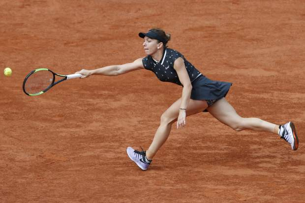 Romania's Simona Halep plays a shot against Poland's Iga Swiatek during their fourth round match of the French Open tennis tournament at the Roland Garros stadium in Paris, Monday, June 3, 2019. (AP Photo/Christophe Ena)