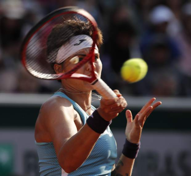 Spain's Aliona Bolsova plays a shot against Amanda Anisimova of the U.S. during their fourth round match of the French Open tennis tournament at the Roland Garros stadium in Paris, Monday, June 3, 2019. (AP Photo/Christophe Ena)