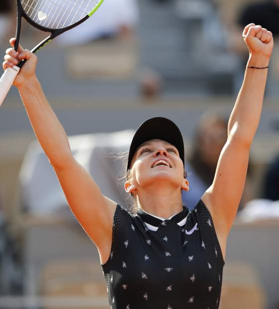 Romania's Simona Halep celebrates winning her fourth round match of the French Open tennis tournament against Poland's Iga Swiatek in two sets, 6-1, 6-0, at the Roland Garros stadium in Paris, Monday, June 3, 2019. (AP Photo/Christophe Ena)