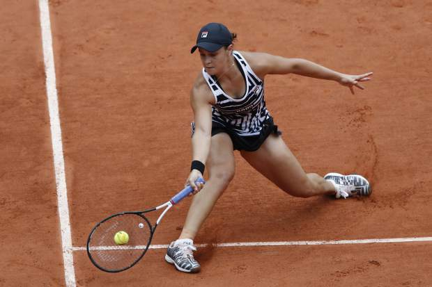 Australia's Ashleigh Barty plays a shot against Sofia Kenin of the U.S. during their fourth round match of the French Open tennis tournament at the Roland Garros stadium in Paris, Monday, June 3, 2019. (AP Photo/Christophe Ena )