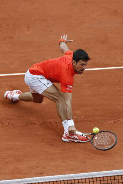 Serbia's Novak Djokovic plays a shot against Germany's Jan-Lennard Struff during their fourth round match of the French Open tennis tournament at the Roland Garros stadium in Paris, Monday, June 3, 2019. (AP Photo/Christophe Ena)