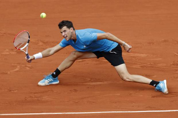 Austria's Dominic Thiem plays a shot against France's Gael Monfils during their fourth round match of the French Open tennis tournament at the Roland Garros stadium in Paris, Monday, June 3, 2019. (AP Photo/Christophe Ena)