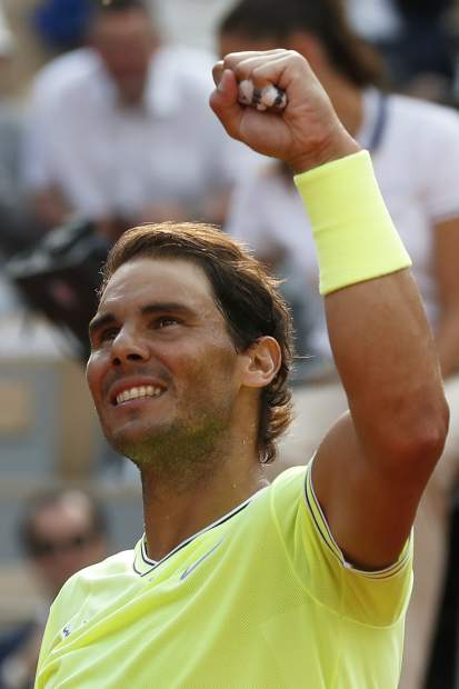 Spain's Rafael Nadal celebrates winning his quarterfinal match of the French Open tennis tournament against Japan's Kei Nishikori in three sets, 6-1, 6-1, 6-3, at the Roland Garros stadium in Paris, Tuesday, June 4, 2019. (AP Photo/Pavel Golovkin)