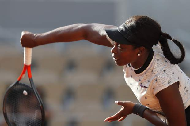Sloane Stephens of the U.S. serves against Spain's Garbine Muguruza during their fourth round match of the French Open tennis tournament at the Roland Garros stadium in Paris, Sunday, June 2, 2019. (AP Photo/Michel Euler)