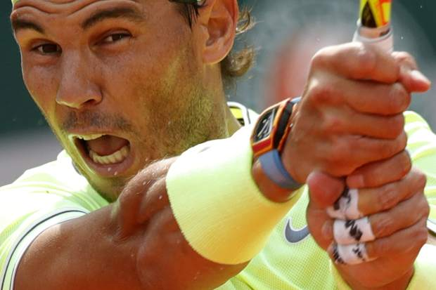 Spain's Rafael Nadal plays a shot against Japan's Kei Nishikori during their quarterfinal match of the French Open tennis tournament at the Roland Garros stadium in Paris, Tuesday, June 4, 2019. (AP Photo/Pavel Golovkin)