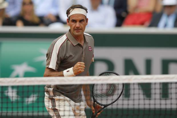 Switzerland's Roger Federer clenches his fist after winning the third set against Switzerland's Stan Wawrinka during their quarterfinal match of the French Open tennis tournament at the Roland Garros stadium in Paris, Tuesday, June 4, 2019. (AP Photo/Michel Euler)