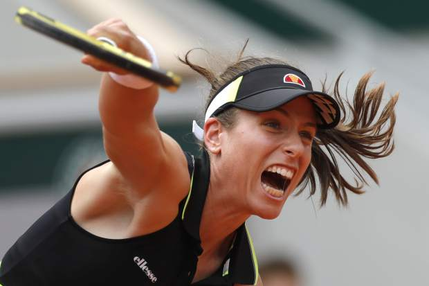 Britain's Johanna Konta plays a shot against Sloane Stephens of the U.S. during their quarterfinal match of the French Open tennis tournament at the Roland Garros stadium in Paris, Tuesday, June 4, 2019. (AP Photo/Pavel Golovkin)