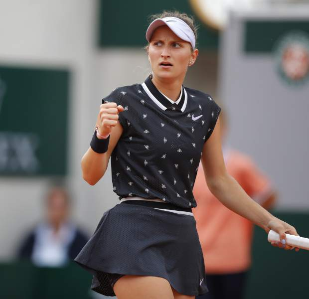 Marketa Vondrousova of the Czech Republic clenches her fist after scoring a point against Croatia's Petra Martic during their quarterfinal match of the French Open tennis tournament at the Roland Garros stadium in Paris, Tuesday, June 4, 2019. (AP Photo/Michel Euler)