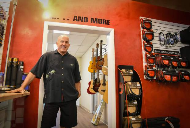 Glenwood Music owner Joe Rodgers stands near the expanded portion of his music shop located in South Glenwood.