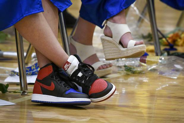 Sometime it is all about the comfort during graduation as ? wears a pair of high tops at Roaring Fork High School in Carbindale.