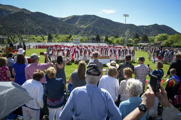 Family members look on as members of the Glenwood Springs class of 2019 take their seats for graduation Saturday.