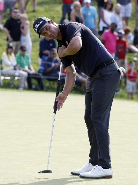 Adam Scott, of Australia, putts on the 18th hole during the final round of the Memorial golf tournament Sunday, June 2, 2019, in Dublin, Ohio. (AP Photo/Jay LaPrete)
