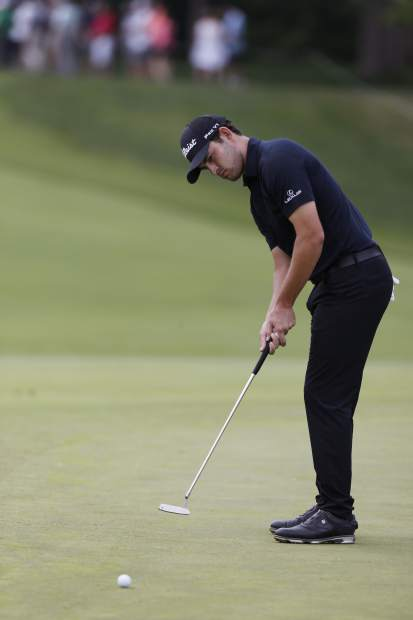Patrick Cantlay putts on the first hole during the final round of the Memorial golf tournament Sunday, June 2, 2019, in Dublin, Ohio. (AP Photo/Jay LaPrete)
