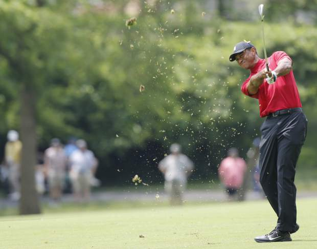 Tiger Woods hits his approach shot on the second hole during the final round of the Memorial golf tournament Sunday, June 2, 2019, in Dublin, Ohio. (AP Photo/Jay LaPrete)